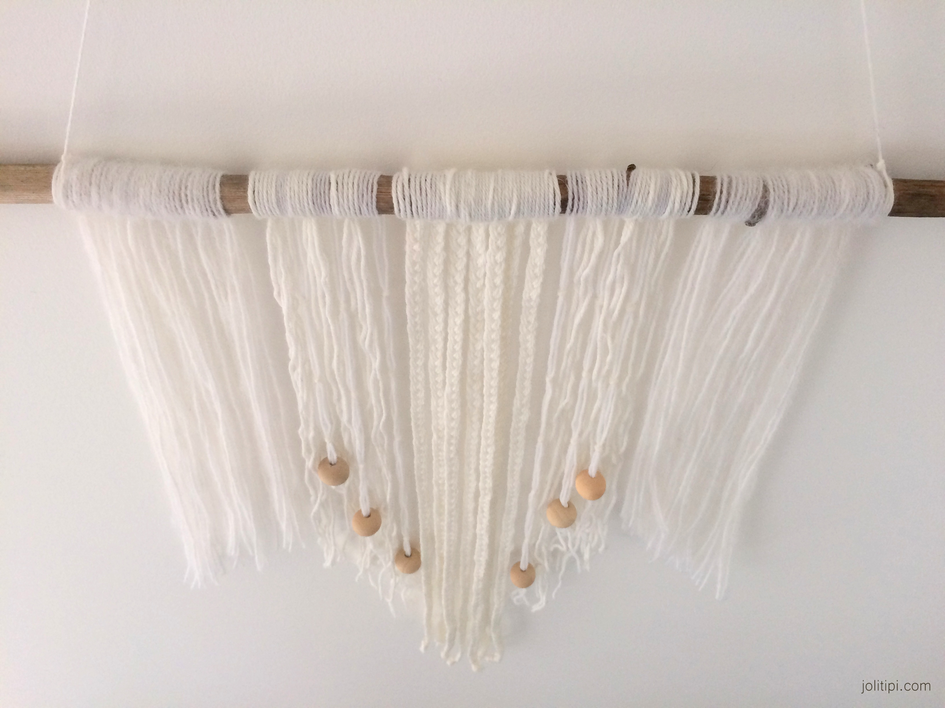 White and wood Bohemian wall hanging